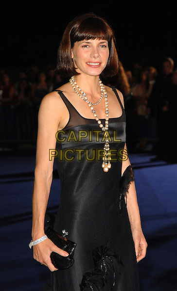 DARCY BUSSELL.attending the Giorgio Armani RED One Night Only.Fashion & Music Party, Earls Court, London, England, 21st September 2006..half length black dress fringe pearl necklace purse emporio.Ref: BEL.www.capitalpictures.com.sales@capitalpictures.com.©Tom Belcher/Capital Pictures.