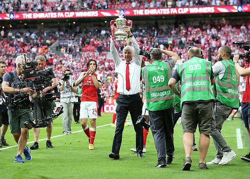 May 27th 2017, Wembley Stadium, London England;  FA Cup Final, Arsenal versus Chelsea FC; Arsenal Manager Manager Arsene Wenger lifts the FA Cup during Arsenal's celebration after defeating Chelsea by 2-1