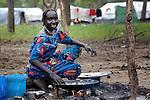 A woman cooks over a fire in the Yusuf Batil refugee camp in South Sudan's Upper Nile State. More than 110,000 refugees were living in four camps in Maban County in October 2012, but officials expected more would arrive once the rainy season ended and people could cross rivers that block the routes from Sudan's Blue Nile area, where Sudanese military has been bombing civilian populations as part of its response to a local insurgency. Conditions in the camps are often grim, with outbreaks of diseases such as Hepatitis E.