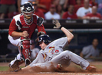 Wednesday, August 8, 2006.The St. Louis Cardinals' shortstop David Eckstein slides safely into homeplate against Cincinnati Reds' catcher David Ross in the fifth inning at Great American Ballpark. Photo by The Enquirer/ Sarah Conard sc