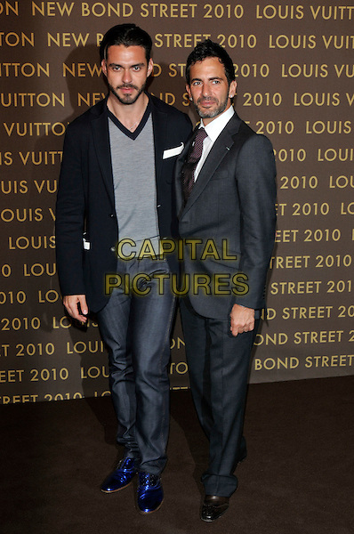 LORENZO MARTONE & MARC JACOBS.attends the launch of the Louis Vuitton Bond Street Maison in London, England, UK, May 25th, 2010. .full length grey gray suit tie blue shoes partner couple .CAP/PL.©Phil Loftus/Capital Pictures.