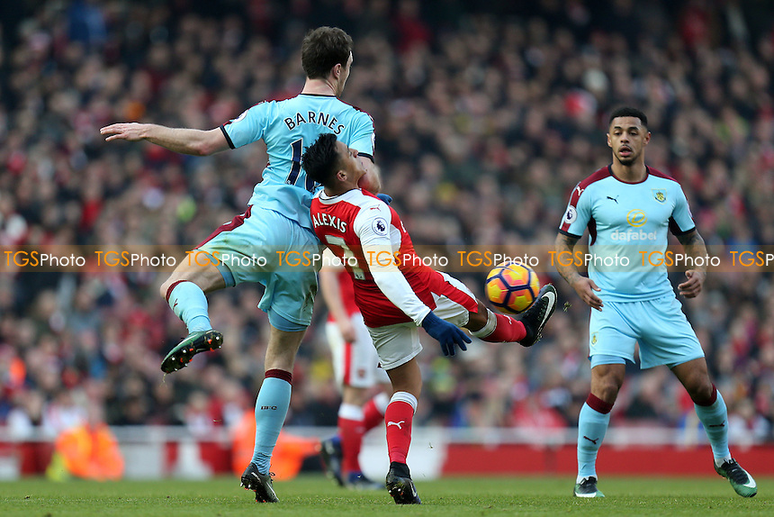 Alexis Sanchez of Arsenal and Ashley Barnes of Burnley during Arsenal vs Burnley, Premier League Football at the Emirates Stadium on 22nd January 2017