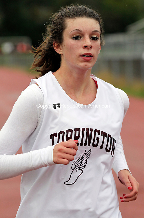 Torrington, CT- 10, October 2011-100411CM06 Torrington's Erin Paretti comes across the finish line in 22:30, over the 3mi course Tuesday afternoon in Torrington.  The Red Raiders hosted Crosby, Holy Cross and Naugatuck.  Christopher Massa Republican-American