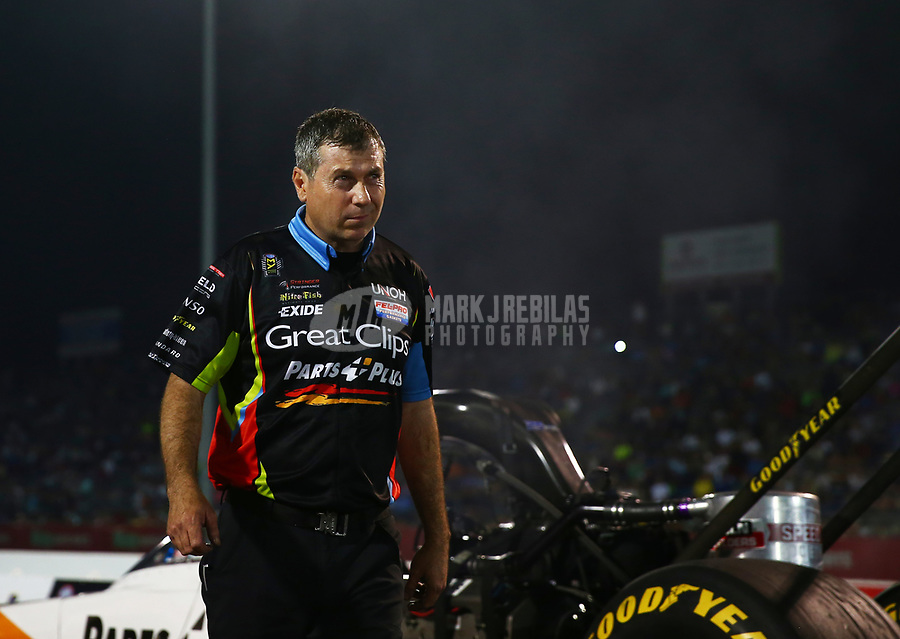 Apr 21, 2017; Baytown, TX, USA; Crew members for NHRA top fuel driver Clay Millican during qualifying for the Springnationals at Royal Purple Raceway. Mandatory Credit: Mark J. Rebilas-USA TODAY Sports