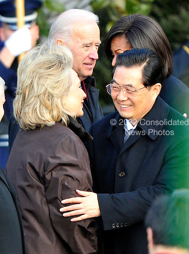 President Hu Jintao of China hugd United States Secretary of State Hillary Rodham Clinton as he arrives at the White House for a State Visit on Wednesday, January 19, 2011. .Credit: Ron Sachs / CNP.(RESTRICTION: NO New York or New Jersey Newspapers or newspapers within a 75 mile radius of New York City)