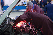 Two instructors examining the engine, Motor Mechanics, Further Education College.