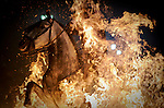 A horseman jumps over a bonfire in the central Spanish village of San Bartolome de Pinares to open the celebrations for the feast of Saint Anthony, patron saint of animals, on January 16, 2012..Todos las noches antes del Día de San Antón, se celebra la fiesta de las Luminarias. Unas veinte hogueras se encienden en las calles del pueblo y casi cien caballos saltan por encima para que el humo les purifique y ahuyente a los malos espíritus. Esta tradición cuenta con más de doscientos años, cuando una epidemia mató a todos los caballos del pueblo..Every night before the Day of St. Anthony, is the Feast of Lights. Some twenty bonfires are lit in the streets of the town and nearly a hundred horses to jump over the smoke to purify them and drive away evil spirits. This tradition has over two hundred years, when an epidemic killed all the horses in town. (c) Pedro ARMESTRE.