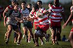 Flanker Fautasi Ma'u looks to fend off Blake Ashby as he makes a run for Karaka. Counties Manukau Premier Club Rugby game between Karaka and Manurewa, played at Karaka, on Saturday June 14 2014. Karaka won the game 63- 24 after leading 32 - 10 at halftime  Photo by Richard Spranger