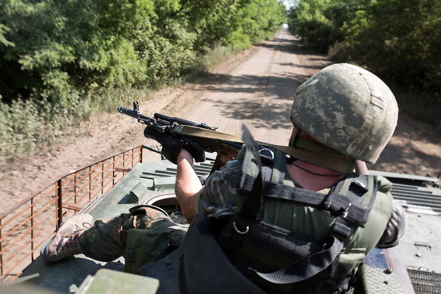 UKRAINE, Pisky: Chemic and Yassin went with infantry fighting vehicle (IFV) to the frontline in order to check shelling near the airport of Donetsk. On the road, Yasin was trying to reach the two towers positions of the separatists with his kalashnikov.<br /> <br /> UKRAINE, Pisky: Chemic et Yasin ont rejoint une ligne de front avec un v&eacute;hicule de combat  afin de constater les bombardements pr&egrave;s de l'a&eacute;roport de Donetsk. Sur la route, Yasin essait d'atteindre les positions des deux tours s&eacute;paratistes avec sa kalachnikov.