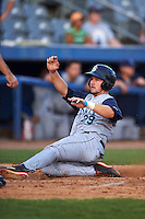 Brooklyn Cyclones third baseman David Thompson (29) slides into home during the first game of a doubleheader against the Connecticut Tigers on September 2, 2015 at Senator Thomas J. Dodd Memorial Stadium in Norwich, Connecticut.  Brooklyn defeated Connecticut 7-1.  (Mike Janes/Four Seam Images)