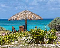 Anegada, British Virgin Islands, Caribbean<br /> Palapa and turquoise water at Cow Wreck Bay