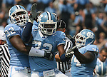 09 September 2006: North Carolina's Barrington Edwards (32) and North Carolina's E.J. Wilson (92) celebrate a North Carolina fumble recovery. The University of North Carolina Tarheels lost 35-10 to the Virginia Tech Hokies at Kenan Stadium in Chapel Hill, North Carolina in an Atlantic Coast Conference NCAA Division I College Football game.