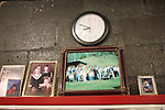 Photos of Bonnell Bentley's family above an old soda machine in his shop, Bentley's Repair Service in Wooten, Ky., including a portrait of a Bennet family reunion, and his daughters. Friday, Oct. 12, 2013. Photo by Judah Taylor