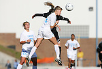 27 November 2009: North Carolina's Kristi Eveland (in white) challenges Wake Forest's Jill Hutchinson (behind) for a header. The University of North Carolina Tar Heels defeated the Wake Forest University Demon Deacons 5-2 at Fetzer Field in Chapel Hill, North Carolina in an NCAA Division I Women's Soccer Tournament Quarterfinal game.