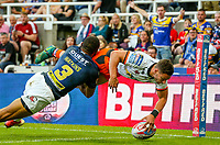 Castleford Tigers' Jv Hitchcox beats Leeds Rhinos' Kallum Watkins to score his side's first try<br /> <br /> Photographer Alex Dodd/CameraSport<br /> <br /> Betfred Super League Round 15 - Magic Weekend - Castleford Tigers v Leeds Rhinos - Saturday 19th May 2018 - St James' Park - Newcastle<br /> <br /> World Copyright &copy; 2018 CameraSport. All rights reserved. 43 Linden Ave. Countesthorpe. Leicester. England. LE8 5PG - Tel: +44 (0) 116 277 4147 - admin@camerasport.com - www.camerasport.com