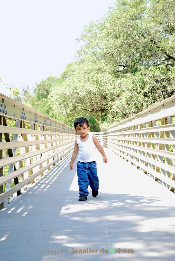 toddler portrait - urban, cat-walking on a bridge
