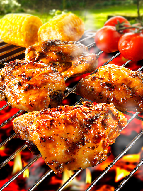 Barbecue chicken legs & thighs on a BBQ grill
