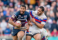 Picture by Allan McKenzie/SWpix.com - 08/04/2018 - Rugby League - Betfred Super League - Wakefield Trinity v Leeds Rhinos - The Mobile Rocket Stadium, Wakefield, England - Leeds's Kallum Watkins is tackled by Wakefield's Bill Tupou.