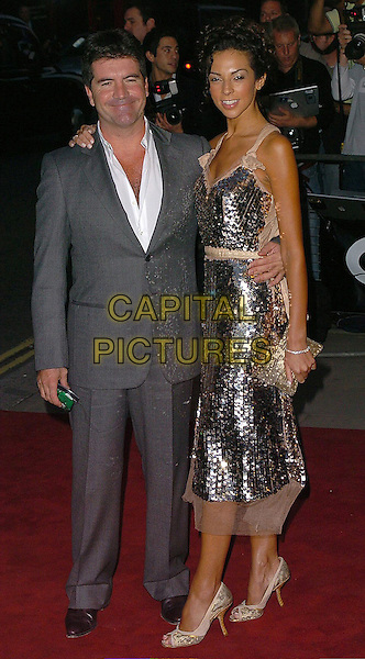 SIMON COWELL & TERRI SEYMORE.The 8th Anual GQ Men of The Year Awards,.The Royal Opera House,.London, 6th September 2005.full length grey gray suit silver sequin dress high heel shoes.www.capitalpictures.com.sales@capitalpictures.com.©Capital Pictures