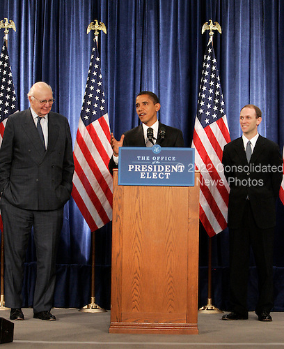 Chicago, IL - November 26, 2008 -- United States President-elect  Barack Obama gestures as he introduces Paul Volcker, left and Austan Goolsbee during a news conference Wednesday, November 26, 2008, in Chicago, Illinois. .Credit: Frank Polich - Pool via CNP