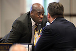 Nevada Sens. Kelvin Atkinson, D-North Las Vegas, left, and Michael Roberson, R-Henderson, talk on the Senate floor at the Legislative Building in Carson City, Nev., on Sunday, June 2, 2013. <br /> Photo by Cathleen Allison