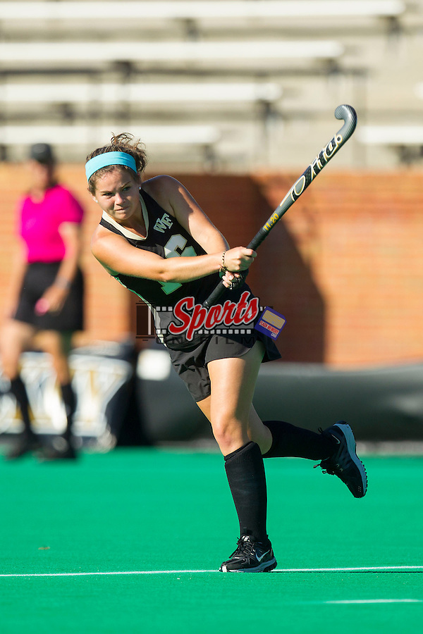 Heather Wiley (16) of the Wake Forest Demon Deacons follows through on a shot on goal during first half action against the Liberty Flames at Kentner Stadium on September 13, 2013 in Winston-Salem, North Carolina.  The Demon Deacons defeated the Flames 3-2.  (Brian Westerholt/Sports On Film)