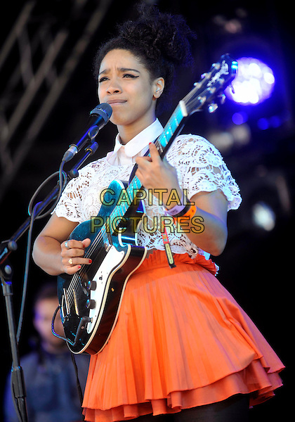 Lianne La Havas.Camp Bestival at Lulworth Castle and Park, Dorset, England..July 26th to 29th 2012.on stage in concert live gig performance performing white lace top orange skirt guitar singing .CAP/ROS.©Steve Ross/Capital Pictures