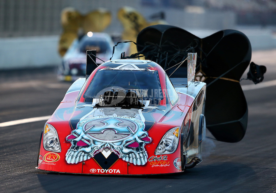 Feb 8, 2014; Pomona, CA, USA; NHRA funny car driver Chad Head during qualifying for the Winternationals at Auto Club Raceway at Pomona. Mandatory Credit: Mark J. Rebilas-