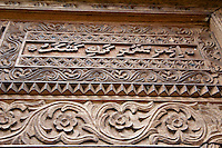 """Mbweni, Zanzibar, Tanzania.  St. John the Evangelist Anglican Church, established 1882, consecrated 1904.  In the top of the carved door frame is an example of Swahili written in Arabic script.  This panel: """"Ingieni mlangoni kwake kwa kushukuru."""" (""""Enter the house of God and give thanks."""")."""