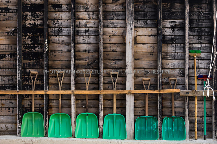 9/8/13 -- Jeungdo Island, Jeonnam Province (Jeollanam-do), South Korea<br /> <br /> Workers at the Taepyeong Salt Farm. Jeungdo began to produce salt around 1950. Jeungdo's sea salt has a high mineral content and exceptional taste. It is harvested by hand in the traditional way, which is the same method used by the upscale French sea salt brand, Guerande. Seawater is dried in shallow pools using only the sun and the wind. Jeungdo&rsquo;s Sea salt can be purchased both in bulk and in small individual packages. Unlike processed table salt, it is rich in minerals and beneficial for your health. <br /> <br /> Photograph by Stuart Isett<br /> &copy;2013 Stuart Isett. All rights reserved.