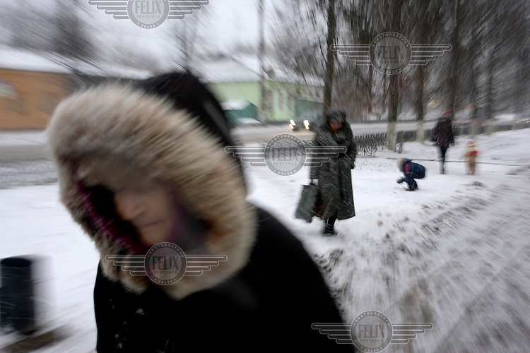 Pedestrians walk in the town of Ludinovo, near the city of Kaluga southwest of Moscow. .Picture by Justin Jin.