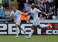 Andre Ayew of Swansea City (R) celebrates his equaliser during the Swansea City FC v Manchester City Premier League game at the Liberty Stadium, Swansea, Wales, UK, Sunday 15 May 2016