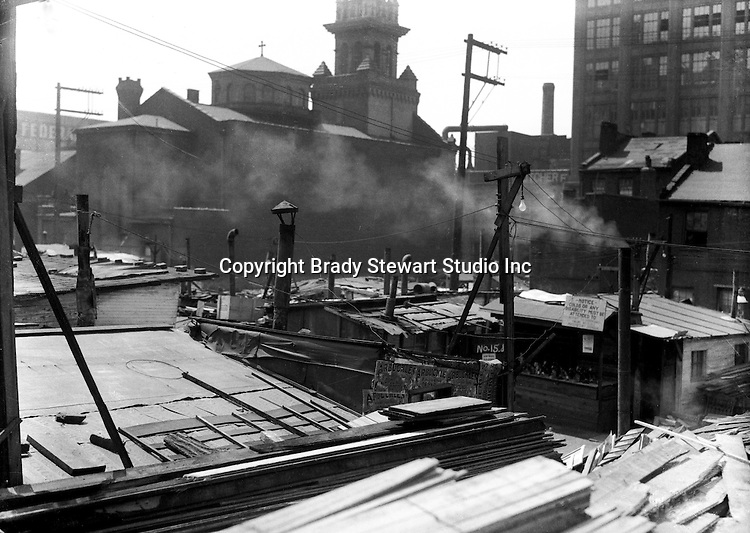 Pittsburgh PA:  Pittsburgh's Shantytown near St Elisabeth's church - the Strip District of Pittsburgh 1930.  During the depression, the area from the PA RR Station to the 17th street bridge was called Shantytown.  Father Cox, a local priest, helped the residents through food kitchens and highlighting their plight.  Brady Stewart photographed the area for the City of Pittsburgh.