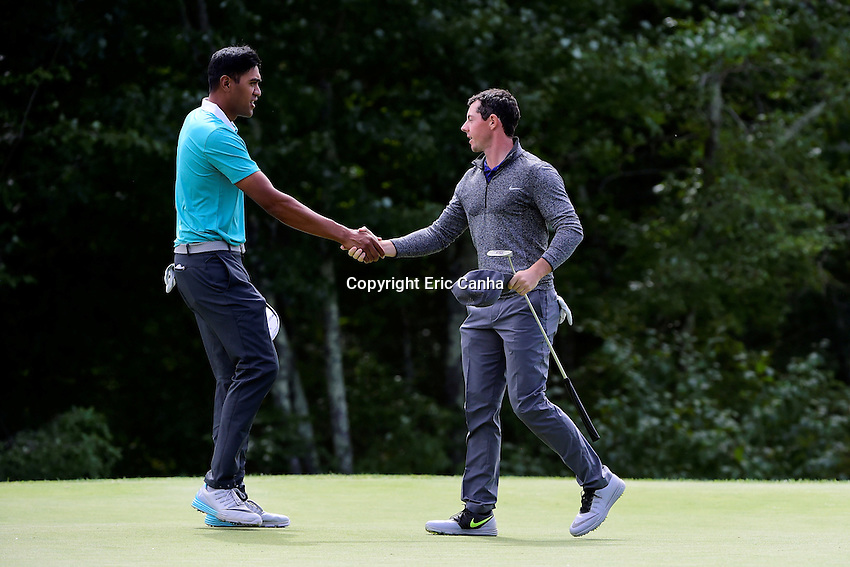 Monday, September 5, 2016:  Tony Finau (left) and  Rory McIlroy of Northern Ireland (right) shake hands on the 18th green during the final round of the Deutsche Bank Championship tournament held at the Tournament Players Club, in Norton, Massachusetts.  Rory McIlroy of Northern Ireland wins the Deutsche Bank Championship with a final tournament score of -15 269.   Eric Canha/Cal Sport Media