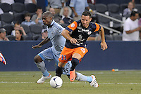 Emanuel Herrera (11) forward Montpellier  holds off Julio Cesar (55) midfield Sporting KC.Sporting Kansas City were defeated 3-0 by Montpellier HSC in an international friendly at LIVESTRONG Sporting Park, Kansas City, KS..