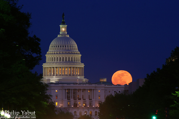 April 25, 2013, moonrise behind the U.S. Capitol.