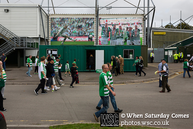 Yeovil Town 0 Queens Park Rangers 1, 21/09/2013. Huish Park, Championship. Fans walking past photographs of Yeovil's 2013 play off win on the Augusta Westland Stand. Photo by Paul Thompson.