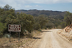 Sign warns travelers of smuggling and illegal immigration along Ruby Road, near Pena Blanca Lake in Coronado National Forest, Arizona.  This part of the road is about three miles from the Mexican border.
