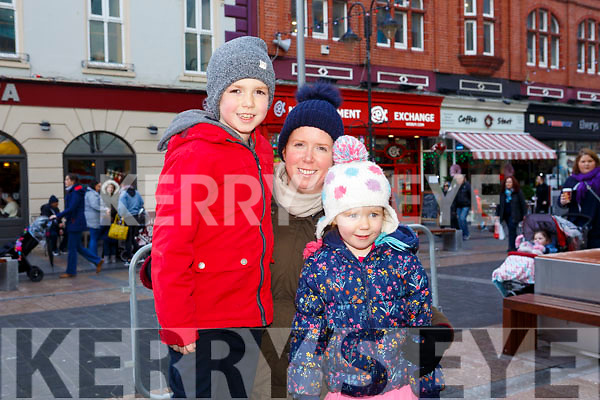 Waiting for Santa at CH Chemist Christmas Parade Tralee on Saturday were Dylan Walsh, Sinead Egan and Isabella Walsh