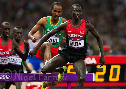 05 AUG 2012 - LONDON, GBR - Abel Kiprop Mutai (KEN) of Kenya clears a hurdle during the men's 3000m Steeplechase final during the London 2012 Olympic Games athletics in the Olympic Stadium at the Olympic Park in Stratford, London, Great Britain .(PHOTO (C) 2012 NIGEL FARROW)