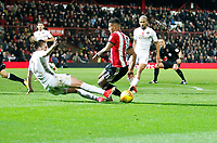 Luke Ayling of Leeds United tackles Ollie Watkins of Brentford during the Sky Bet Championship match between Brentford and Leeds United at Griffin Park, London, England on 4 November 2017. Photo by Carlton Myrie.