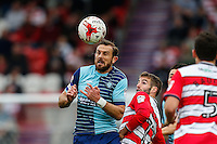 Paul Hayes of Wycombe Wanderers heads the ball during the Sky Bet League 2 match between Doncaster Rovers and Wycombe Wanderers at the Keepmoat Stadium, Doncaster, England on 29 October 2016. Photo by David Horn.