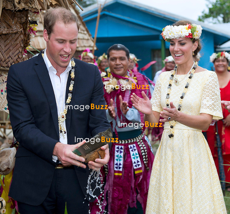 CATHERINE, DUCHESS OF CAMBRIDGE AND PRINCE WILLIAM.seated in chairs are carried on the shoulders of local men and women on arrival at Funafuti, Tuvalu_18/09/2012.