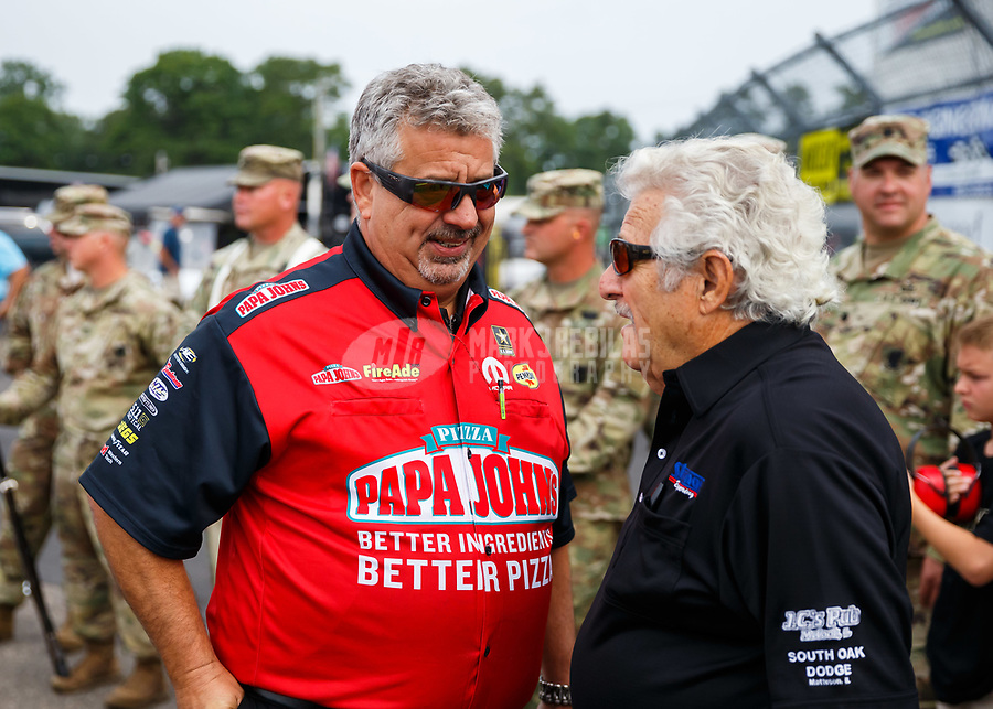 Aug 20, 2017; Brainerd, MN, USA; Joe Barlam (left) talks with NHRA top fuel driver Chris Karamesines during the Lucas Oil Nationals at Brainerd International Raceway. Mandatory Credit: Mark J. Rebilas-USA TODAY Sports
