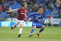 Cardiff City's Joe Bennett and West Ham United's Mark Noble<br /> <br /> Photographer Rob Newell/CameraSport<br /> <br /> The Premier League - Cardiff City v West Ham United - Saturday 9th March 2019 - Cardiff City Stadium, Cardiff<br /> <br /> World Copyright © 2019 CameraSport. All rights reserved. 43 Linden Ave. Countesthorpe. Leicester. England. LE8 5PG - Tel: +44 (0) 116 277 4147 - admin@camerasport.com - www.camerasport.com