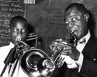 The great Louie Armstrong plays with a Oakland, Ca teen  (photo/Ron Riesterer)