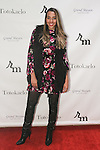 Courtney Wade attends the 3rd Annual Wives' Holiday Soiree at Totokaelo in SOHO on December 9, 2015.