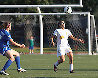Western New York Flash midfielder Angela Salem (6) controls the ball. In a National Women's Soccer League (NWSL) match, Boston Breakers (blue) tied Western New York Flash (white), 2-2, at Dilboy Stadium on August 3, 2013.