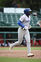 Jameson Hannah (5) of the Stockton Ports runs to first base during a game against the Inland Empire 66ers at San Manuel Stadium on May 26, 2019 in San Bernardino, California. (Larry Goren/Four Seam Images)