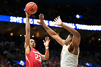 NWA Democrat-Gazette/CHARLIE KAIJO Arkansas Razorbacks guard C.J. Jones (23) shoots as Tennessee Volunteers forward Admiral Schofield (5) covers during the Southeastern Conference Men's Basketball Tournament semifinals, Saturday, March 10, 2018 at Scottrade Center in St. Louis, Mo. The Tennessee Volunteers knocked off the Arkansas Razorbacks 84-66